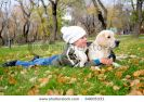 boy-playing-in-autumn-park-with-a-golden-retriever-64605331-thumbnail
